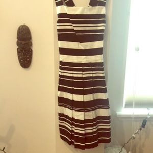 Pleated sleeveless dress with cross strap back